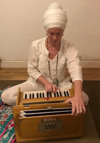 Gemma Bliss playing the harmonium